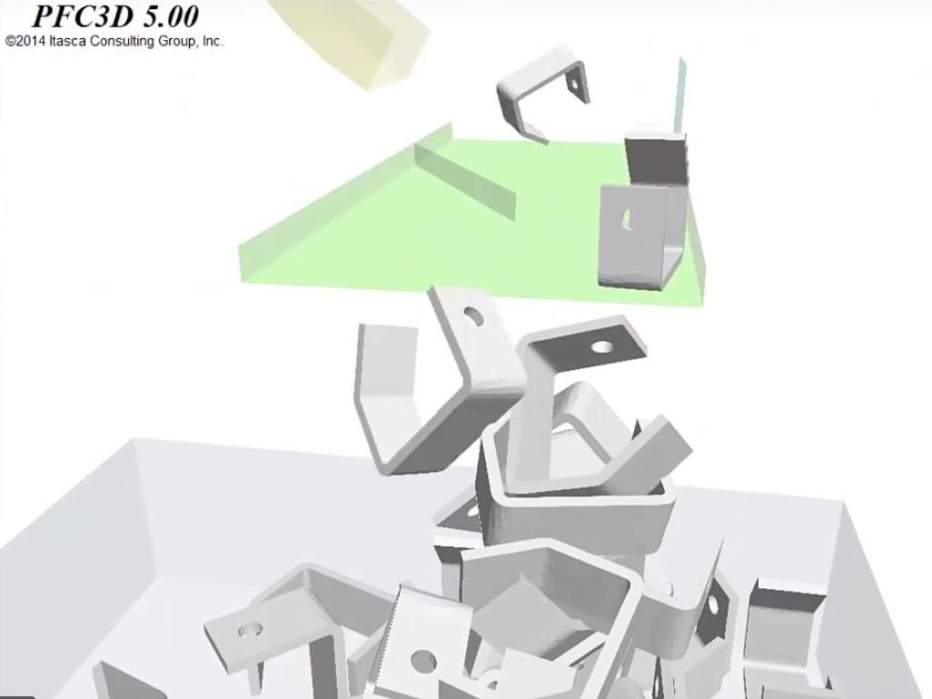 Modélisation de la chute et du convoyage de pièces métalliques (source PFC3D - ITASCA)
